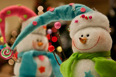 Snowmen. Two snowmen in front of a Christmas tree Royalty Free Stock Images