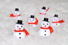 Snowmen. Make their way through a snowy wilderness Royalty Free Stock Image
