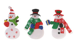 Snowmen. Three colorful Christmas snowmen isolated over a white background Royalty Free Stock Image