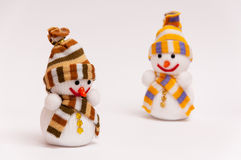 Snowmen. Christmas snowmen on a white background Stock Images