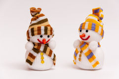 Snowmen. Christmas snowmen on a white background Royalty Free Stock Photos