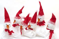 Snowmen. Group of hand made snowmen with Xmas caps (paper toys Royalty Free Stock Image