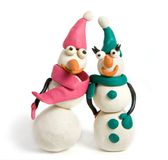 Snowmen. Family of snowmen made with plasticine stock photography