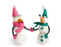 Snowmen. Family of snowmen made with plasticine stock image