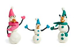Snowmen. Family of snowmen made of plasticine Royalty Free Stock Photo