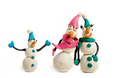 Snowmen. Family of snowmen made of plasticine stock image
