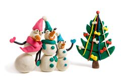 Snowmen. Plasticine family of snowmen with christams tree Royalty Free Stock Photography