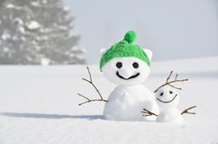 Snowmen against Swiss Alps Stock Images