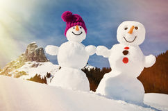 Snowmen against Swiss Alps Royalty Free Stock Image