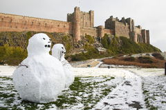 Snowmen at Bamburgh Castle Royalty Free Stock Images