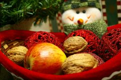 Snowmen with basket of fruits. Snowmen with basket of christmas presents royalty free stock photography