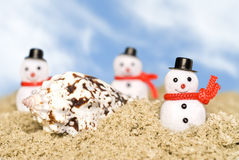 Snowmen on beach Stock Image