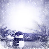 Snowmen blue wooden panel winter Royalty Free Stock Photo