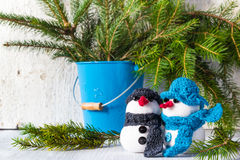 Snowmen board wooden Christmas winter plush duo Stock Photo