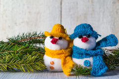 Snowmen board wooden Christmas winter plush duo. Plush soft snowmen on white wooden background Stock Images