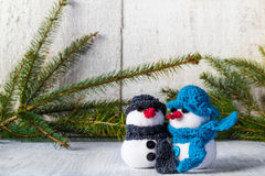 Snowmen board wooden Christmas winter plush duo Royalty Free Stock Images