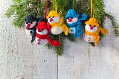Snowmen board wooden Christmas winter plush team family. Family plush snowmen on white wooden background Stock Photos
