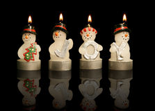 Snowmen Candles. Holding letters spelling out joy Stock Photos