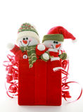 Snowmen and Christmas Box. Red Christmas Box With Snowmen Royalty Free Stock Photos