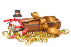 Snowmen, Christmas gift box with gold ball Stock Photography