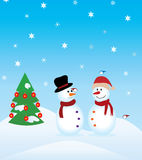 Snowmen and christmas tree Royalty Free Stock Photo