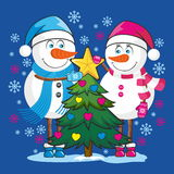 Snowmen with Christmas tree Royalty Free Stock Image