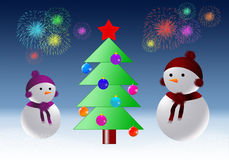 Snowmen with Christmas tree. Two snowmen look at the Christmas tree in the background salute Stock Photo