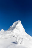 Snowmen climbing up a icy mountain Royalty Free Stock Photo