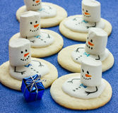 Snowmen of cookies and marshmallow on a blue background Royalty Free Stock Image
