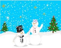 Snowmen couple enjoying the winter day! royalty free stock photography