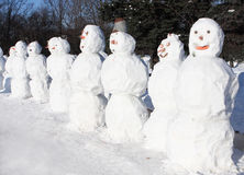 Snowmen crowd Stock Photography