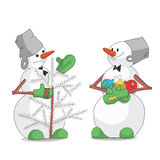 Snowmen decorating Christmas tree Royalty Free Stock Photos
