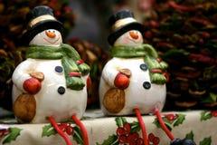 Snowmen decorations. Two funny Christmas snowmen decorations Royalty Free Stock Photo