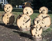 Snowmen. Details tree mountain tourism tourist garden Park wood handmade toys Royalty Free Stock Image