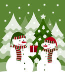 Snowmen and gift. Pair of snowmen and gift Royalty Free Stock Photography