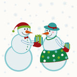 Snowmen give gifts Royalty Free Stock Image