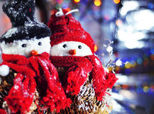 Snowmen. In hats waiting for holiday Royalty Free Stock Photos