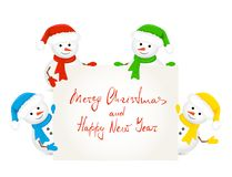 Snowmen holding card with text Merry Christmas. Christmas theme with four snowmen in Santa hats are holding a card with text Merry Christmas and Happy New Year Stock Photo