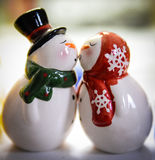 Snowmen kissing. Snowman salt and pepper shakers kissing Stock Photography