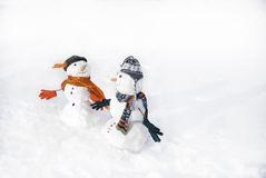 Snowmen. In love taking hand each other Stock Image
