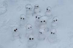 Snowmen. Many snowmen, hurt, sad, serious, funny, huge, normal winter day or Snowmen are on the field Stock Photos