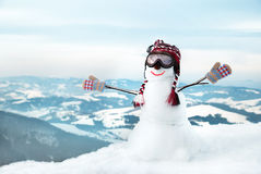 Snowmen at the mountains. With mask Stock Images