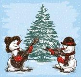 Snowmen musicians at a Christmas tree Stock Image