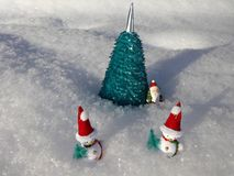 Snowmen near the artificial Christmas tree in the snow Stock Photo
