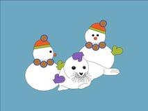 Snowmen och förseglar Arkivbilder