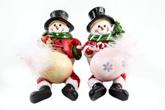 Snowmen. A pair of snowmen figurines for the Christmas holiday Royalty Free Stock Images
