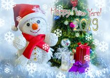 Snowmen. Snowfall. . happy new year Greeting card. Snowmen. postcard . snowmen with a gift on a background with Christmas trees, snow falls Royalty Free Stock Photography