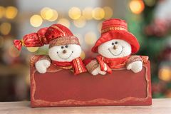 Snowmen with red board royalty free stock photography