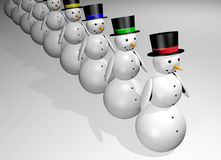 Snowmen in a row. Several snowmen with black hats standing in a row Royalty Free Stock Photography