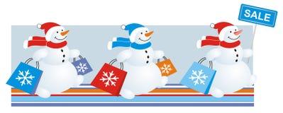 Snowmen sale. Sale banner,  snowmen with color sales bags Stock Images